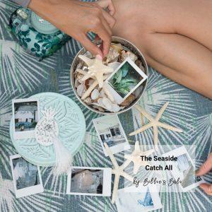 Seashells and nick knacks inside teal tin with pineapple
